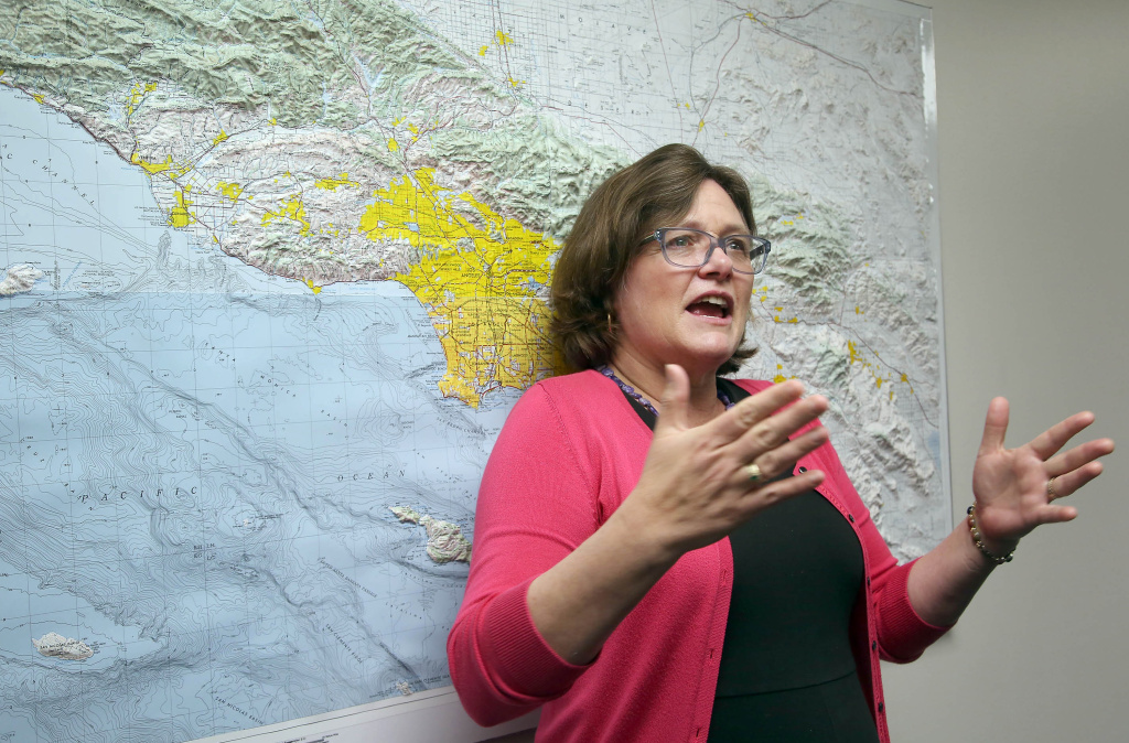 In this file photo, Lucy Jones, a USGS seismologist talks during a news conference at Caltech in Pasadena, Calif, on Monday, March 17, 2014. In a tweet Friday, Jones said she was leaving federal service but would continue working at Caltech.