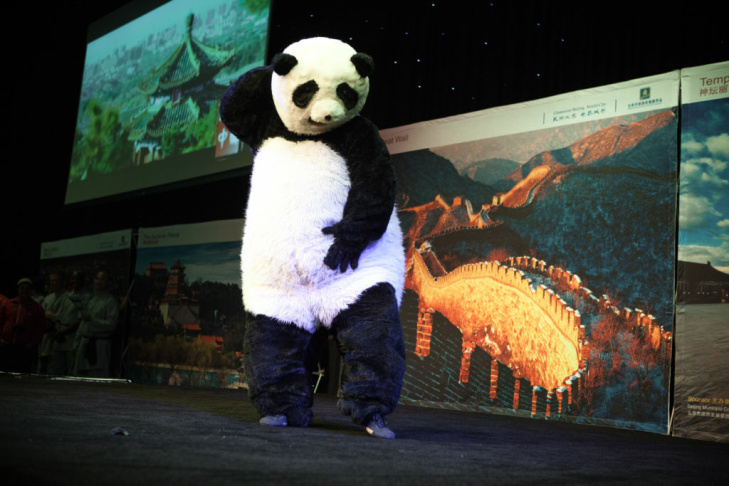 A panda acrobat performs at the opening ceremony of the Beijing cultural fair at Universal Studios.