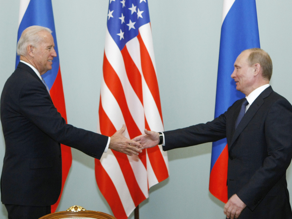 In this March 10, 2011, file photo, Joe Biden, then vice president, shakes hands with Vladimir Putin, then Russia's prime minister, in Moscow. President Biden will hold a summit with Putin this week in Geneva, a face-to-face meeting between the two leaders that comes amid escalating tensions between the U.S. and Russia.