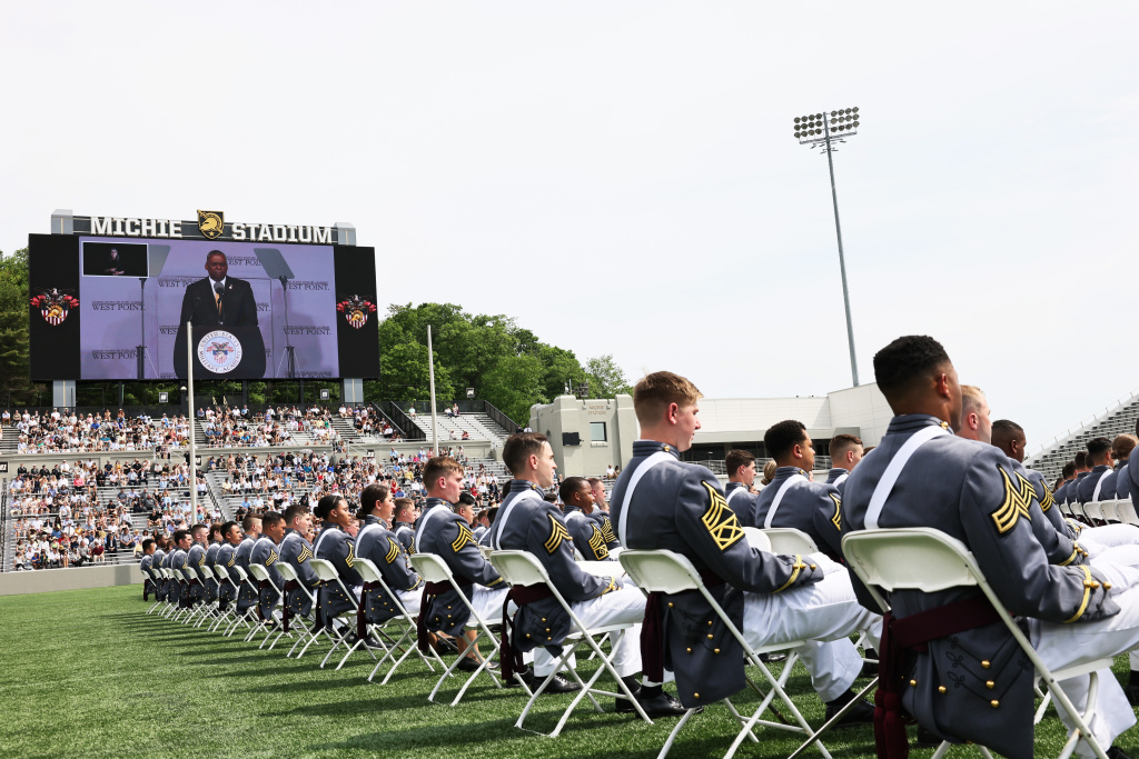West Point graduates watch as U.S. Secretary of Defense Lloyd J. Austin III speaks during the 2021 West Point Commencement Ceremony on May 22, 2021 in West Point, New York. the U.S. Military Academy's Class of 2021 commencement address.