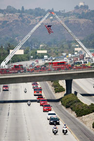Firefighters escort the body of fallen firefighter Capt. Tedmund Hall, one of two firefighters who died in the 226-square-mile Station Fire, to a mortuary in Victorville, California on September 4, 2009 in Glendale, California.