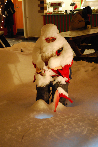Santa fishing in the snow.