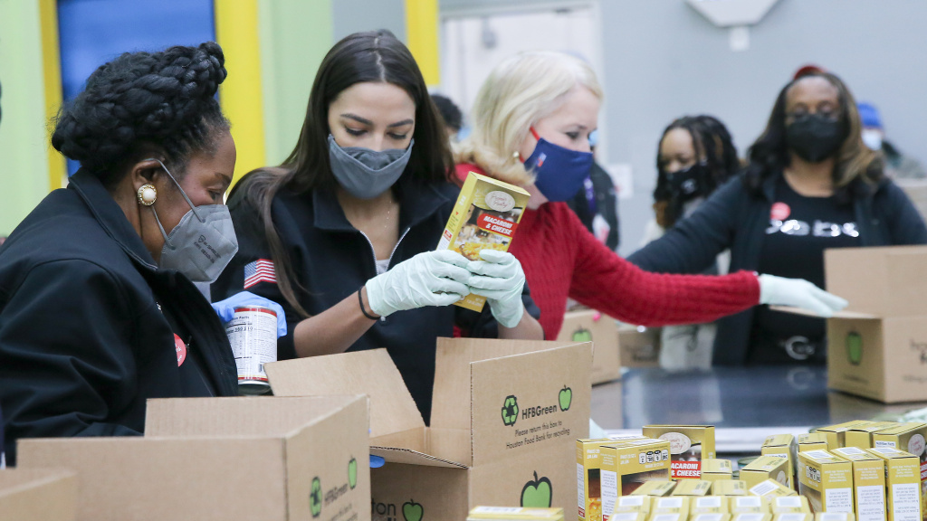 Reps. Sheila Jackson Lee, Alexandria Ocasio-Cortez and Sylvia Garcia help distribute food at the Houston Food Bank on Saturday.