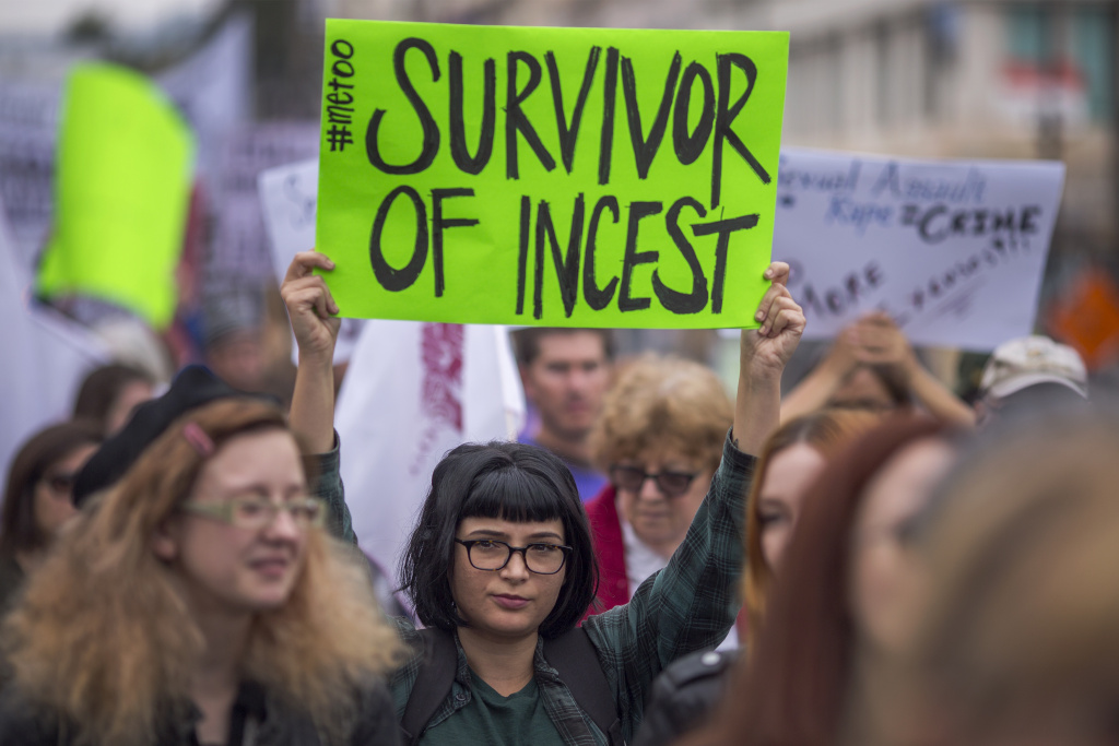 Demonstrators participate in the #MeToo Survivors' March outside the CNN building in response to several high-profile sexual harassment scandals on November 12, 2017 in Los Angeles, California.