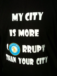 One Bell resident expressed his outrage over exorbitant pay for city officials on his T-shirt at a recent community meeting.