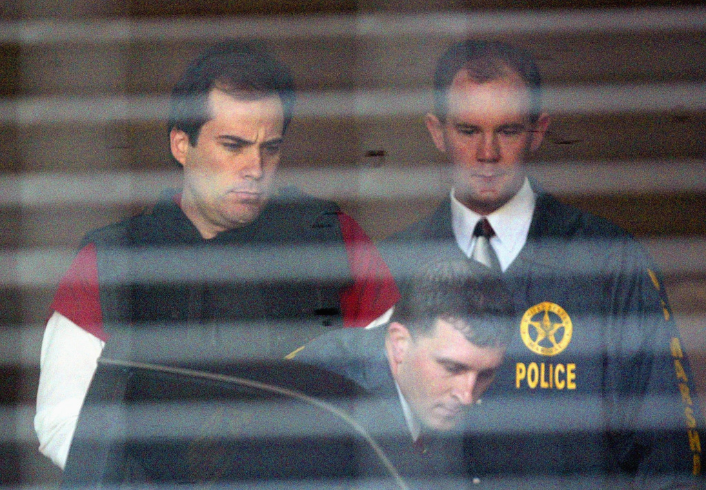 Eric Rudolph, left, is led to a waiting police car by U.S. Marshals as he leaves the Jefferson County Jail for a hearing in Birmingham, Alabama.