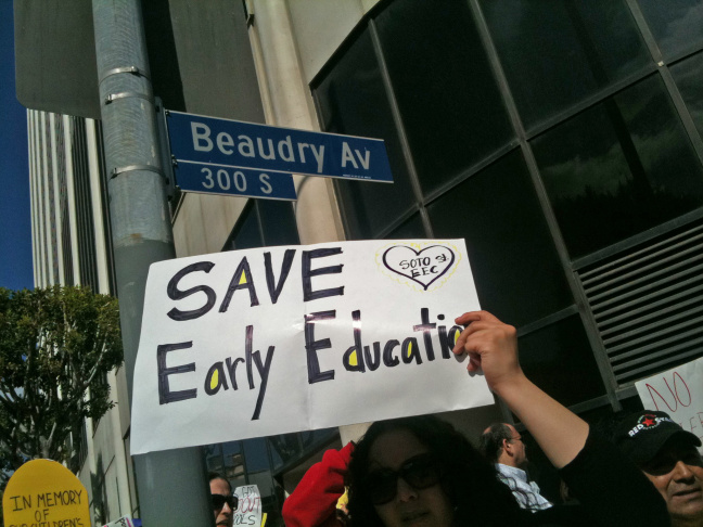 Several hundred people protested outside L.A. Unified headquarters as the school board was set to cut funding to preschool and adult education to close a $557 million funding deficit.