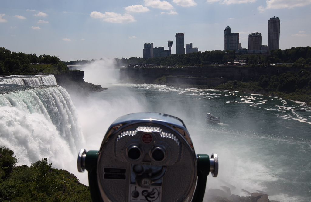 A tour boat heads past Niagara Falls on the U.S.-Canada border June 15, 2012 as seen from from Niagara Falls, New York.