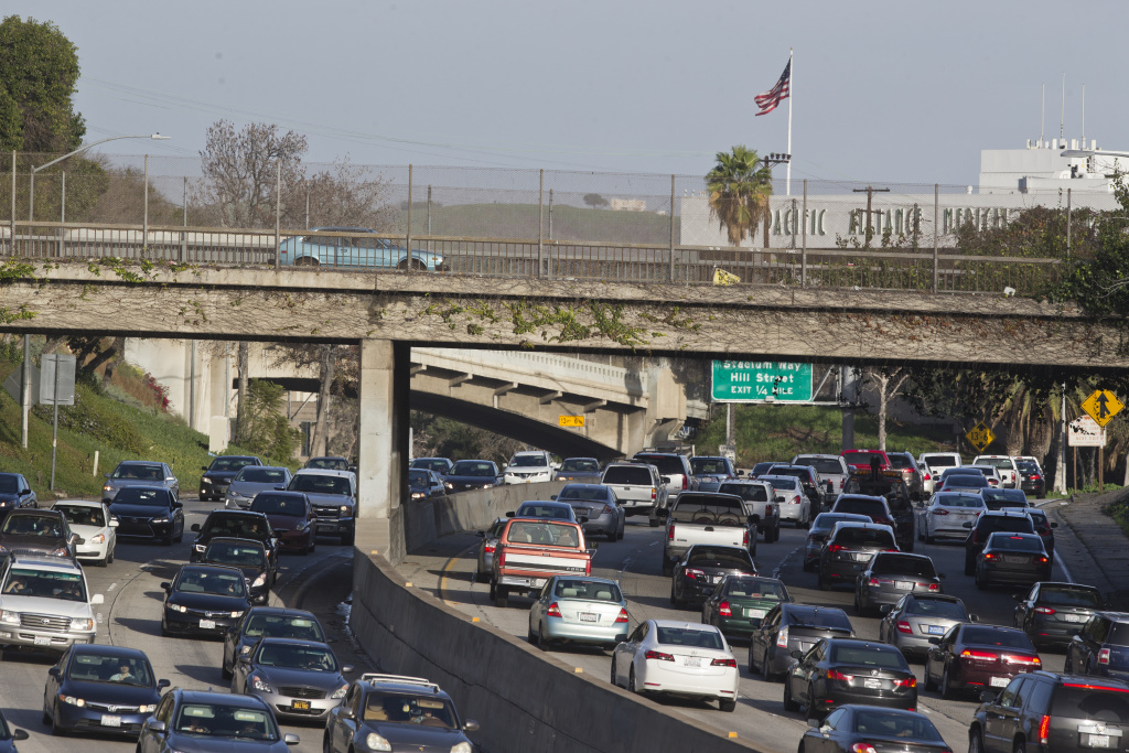 ADDS CREATION DATE - Vehicles crowd on the Arroyo Seco Parkway near downtown Los Angeles near Dodger Stadium on Wednesday, Jan. 11, 2017. In January 2017, a California lawmaker wants to name a section of the roadway in honor of Vin Scully, the legendary broadcaster who retired last year after calling Dodger games for 67 seasons. (AP Photo/Damian Dovarganes)