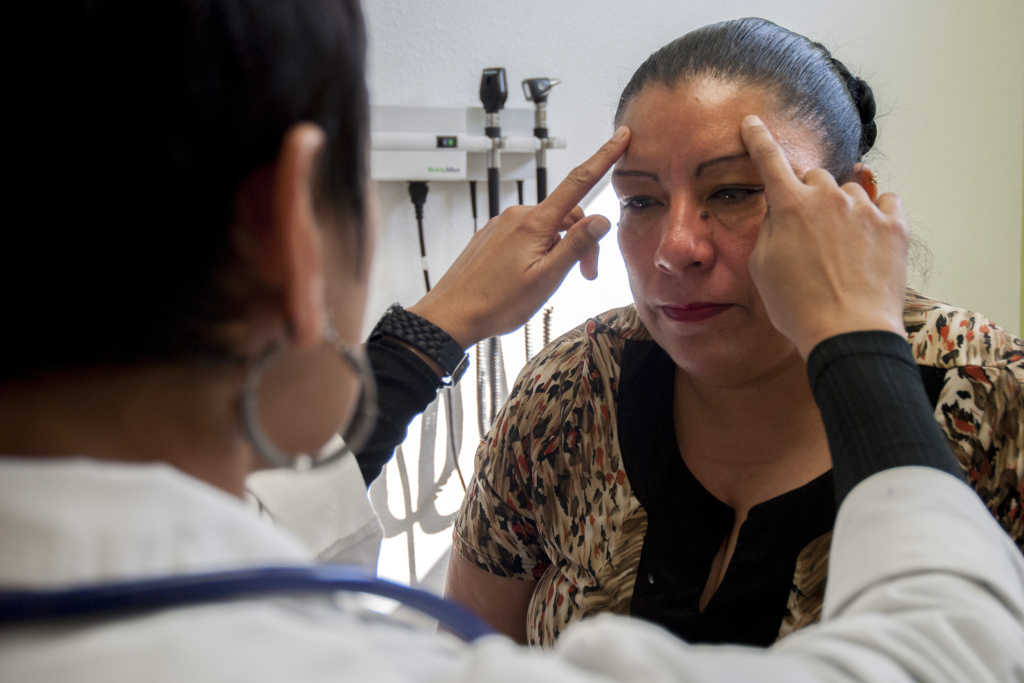 Rosaura Guizar, a patient at the UMMA Clinic in South Los Angeles, receives medical treatment on March 12 from Simmi Gandhi, nurse practitioner. This clinic and others like it are relying more on the skills of its nursing staff as the growing number of patients strains the ratio between caregivers and those in need of medical attention.