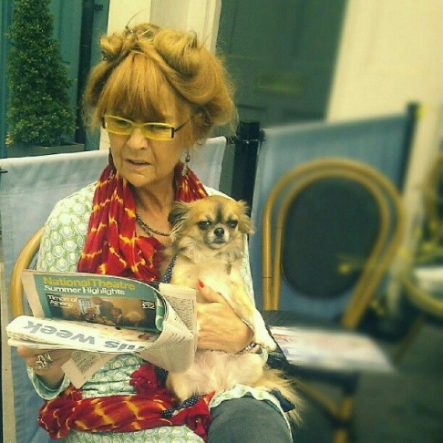 A woman reads the National Theater Summer Highlights with her dog in London. Diane Davis captured this winning image for our Perfect Strangers Instagram Contest.