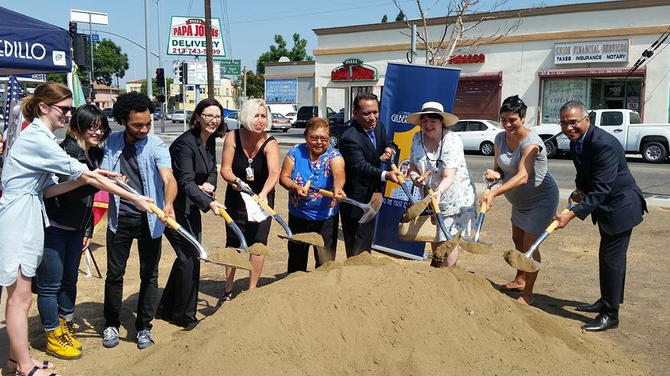 Members of the University Park community, people from USC's School of Architecture, the Los Angeles Bureau of Street Services, and Councilman Gil Cedillo, and a representative from the Housing and Community Investment Department participate in a ground-breaking ceremony for the Hoover Triangle project on Sept. 8, 2016.