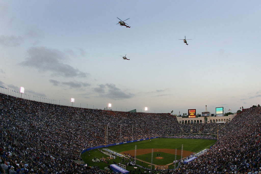 Helicopters fly over the Los Angeles Memorial Coliseum before the Boston Red Sox take on the Los Angeles Dodgers on March 29, 2008 in Los Angeles, California. Landlords of the Coliseum have granted USC control over the historic arena for the next century.