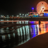Visitors enjoy the beach near Santa Monica's Pier during the Glow 2013 on September 29, 2013 at the beach in Santa Monica