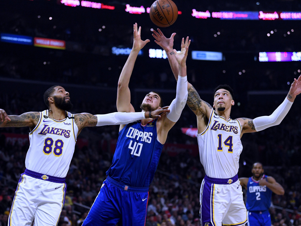 Players from the Los Angeles Clippers and Los Angeles Lakers, shown here during a game in March, will face each other on Thursday evening as the NBA season restarts.