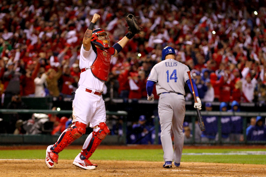 Yadier Molina #4 of the Cardinals celebrates as Mark Ellis #14 of the Dodgers strikes out as St. Louis defeats Los Angeles 9-0 in Game Six of the National League Championship Series at Busch Stadium on October 18, 2013 in St Louis, Missouri.