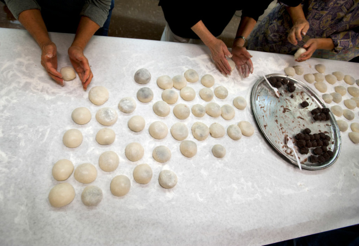 Volunteers and members of the Higashi Honganji Buddhist Temple in Little Tokyo make mochi from scratch on Friday morning as part of a Japanese New Year's Tradition.