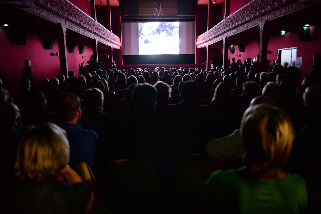 People watch a movie at the world's oldest cinema theater