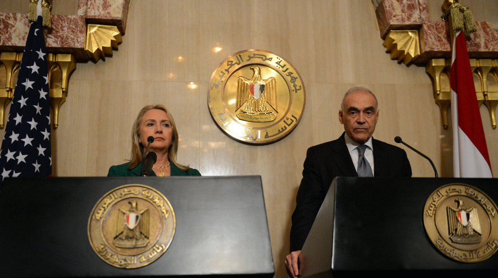 Egyptian Foreign Minister Mohamed Kamel Amr (R) and US Secretary of state Hilary Clinton give a joint press conference after their meeting with President Mohamed Morsi in the presidential palace in Cairo on November 21, 2012. Amr announced that a truce had been agreed between Israel and Hamas to end a week of bloodshed in and around Gaza and said a ceasefire would take effect at 1900 GMT.