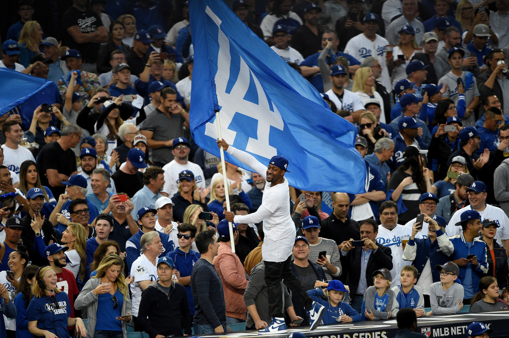 Actor Jaleel White waves the Los Angeles Dodgers flag prior to game seven of the 2017 World Series between the Houston Astros and the Los Angeles Dodgers at Dodger Stadium on November 1, 2017 in Los Angeles, California.