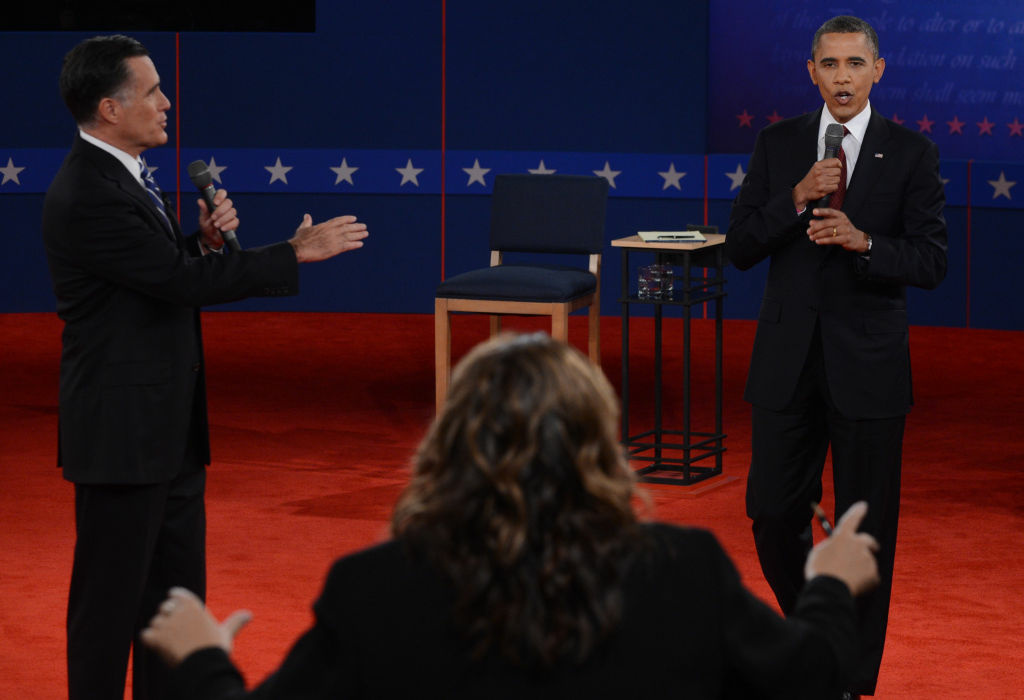 CNN's Candy Crowley (C) conducts the second presidential debate with US President Barack Obama (R) and Republican presidential candidate Mitt Romney (L) at the David Mack Center at Hofstra University in Hempstead, New York, October 16, 2012.