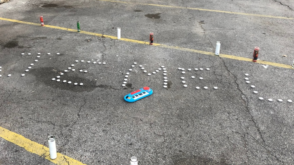 By Tuesday afternoon, a small memorial had sprung up for Roberson in Manny's parking lot. Candles spelled out his first name, and a small, brightly colored electric keyboard lay next to them.