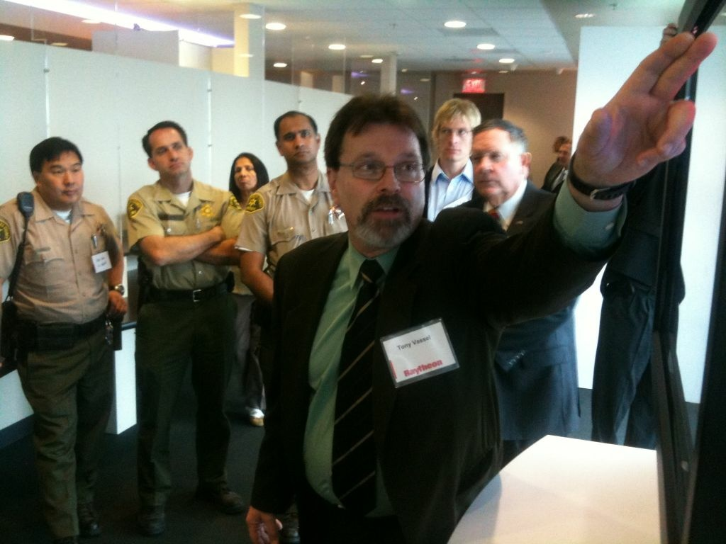 Raytheon's Tony Vassel demonstrates public safety technology for LA county sheriff's deputies