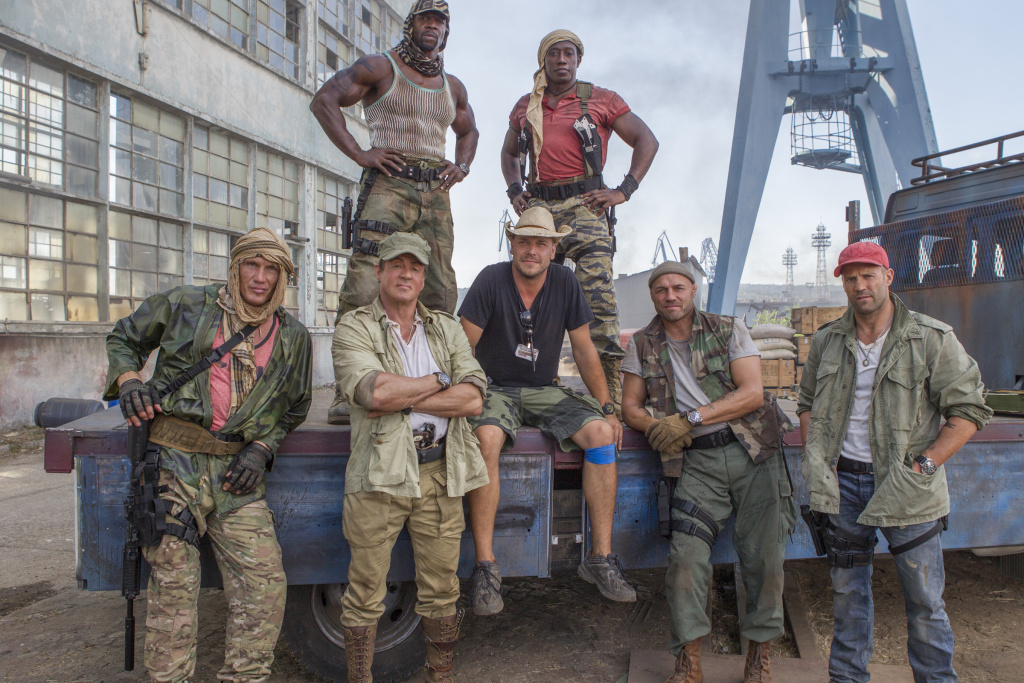 (From left to right) Dolph Lundgren, Terry Crews, Sylvester Stallone, Patrick Hughes, Wesley Snipes, Randy Couture, and Jason Statham on the set of