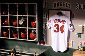 The jersey of Los Angeles Angels pitcher Nick Adenhart, who was killed on April 9, 2009 in a car crash, hangs in the dugout during the baseball game against the Boston Red Sox at Angel Stadium April 10, 2009 in Anaheim, California.