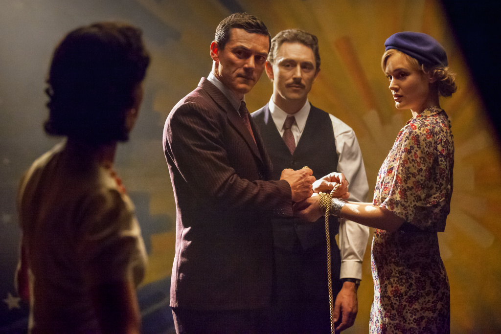 (l-r.) Rebecca Hall stars as Elizabeth Marston, Luke Evans as Dr. William Marston, JJ Feild as Charles Guyette and Bella Heathcote as Olive Byrne in PROFESSOR MARSTON AND THE WONDER WOMEN, an Annapurna Pictures release. Credit: Claire Folger / Annapurna Pictures