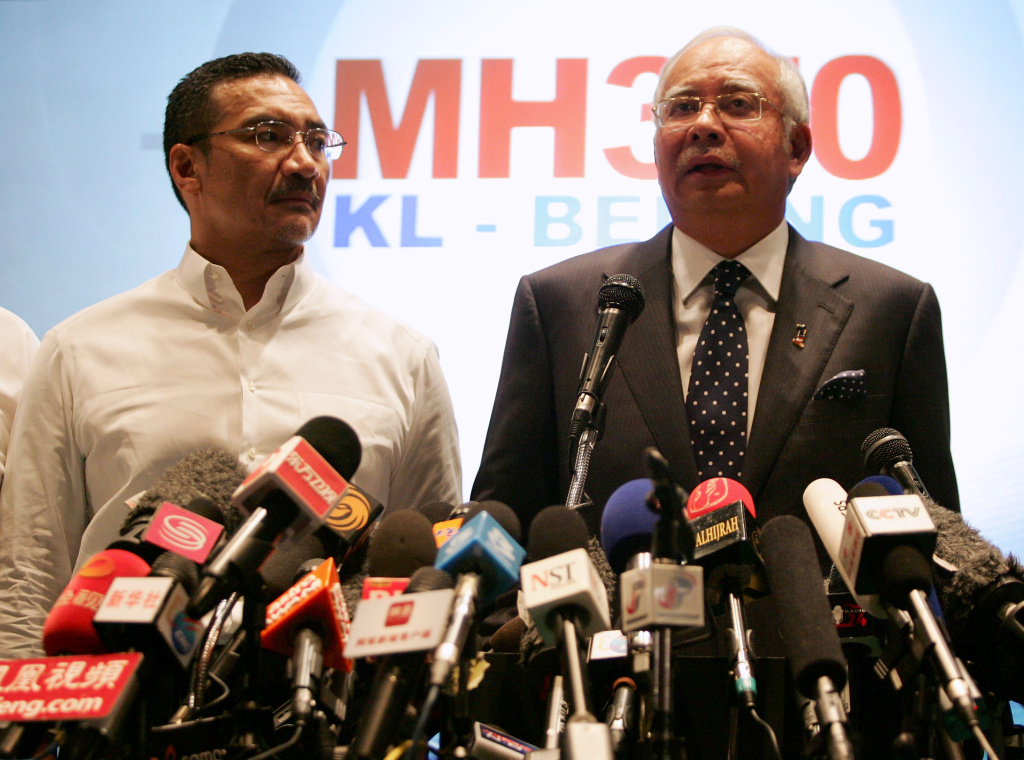 Datuk Hishammuddin Hussein (L), acting Minister of Transport and Malaysian Prime Minister Najib Abdul Razak update the media on the search and rescue plan for the missing MAS Airlines flight MH370 during a press conference on March 15, 2014 in Kuala Lumpur, Malaysia.