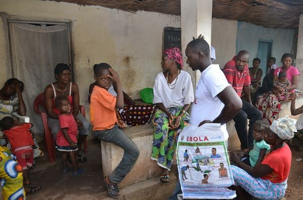 Door-to-door public education on Ebola in Sierra Leone.