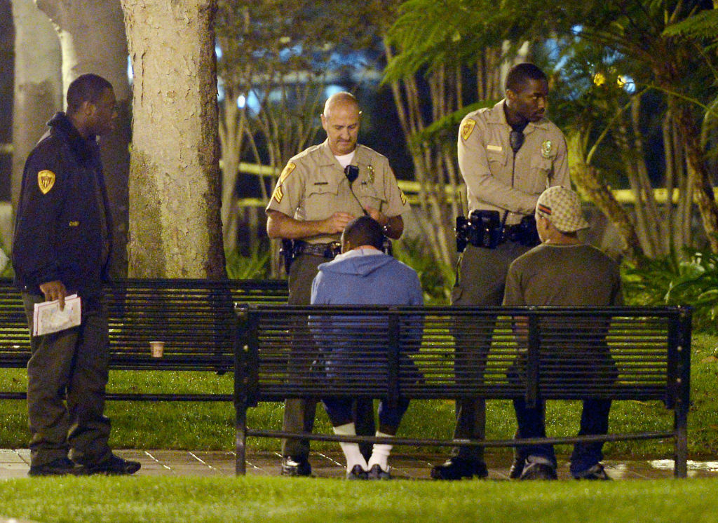 A USC Department of Public Safety officers question suspects after four people were shot including one in critical condition during a Halloween party at the Tutor Campus Center on November 1, 2012 in Los Angeles, California. Prosecutors say Brandon Spencer was shooting at a rival gang member, hitting him and three others. He has been sentenced to 40 years in prison.