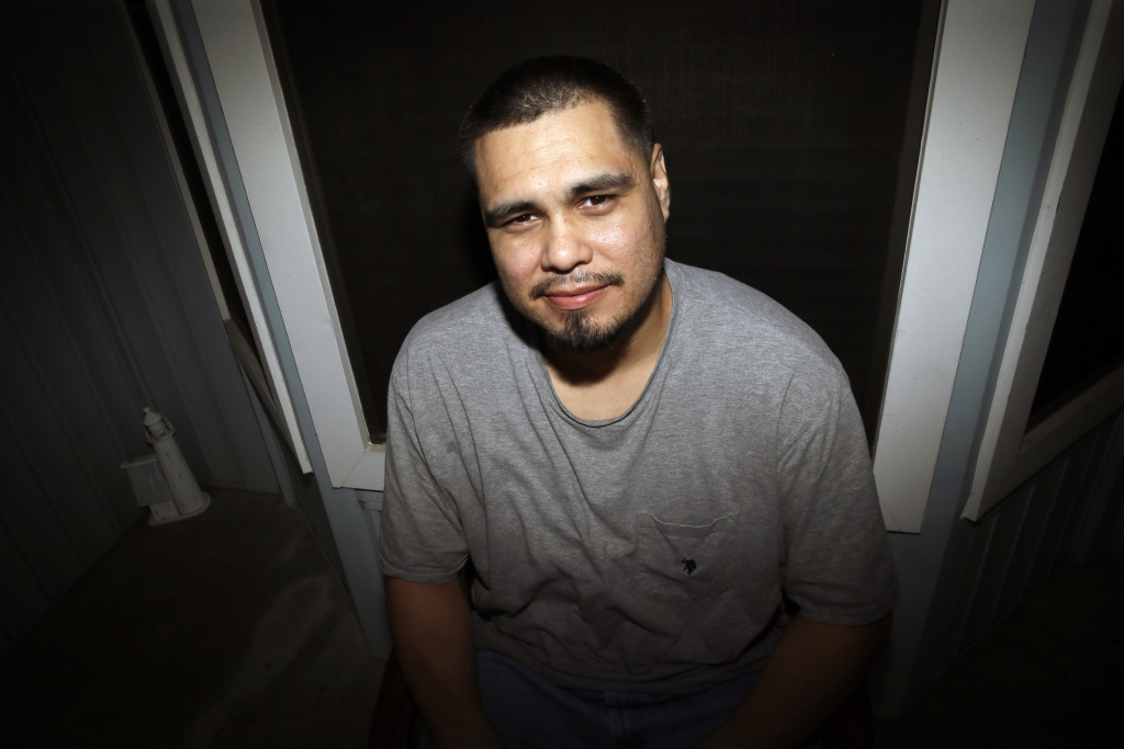 In this Tuesday, Sept. 6, 2016 photo, James Ochoa poses for a photo outside his home in Grand Prairie, Texas. Ochoa, who was on probation for drug possession when he was arrested for a carjacking, pleaded guilty to second-degree armed robbery and spent about a year in prison before DNA linked the carjacking to another man in 2006. Ochoa was cleared and released within days. More than 300 of the nearly 1,800 people who have been exonerated, or found innocent, since 1989 pleaded guilty even though they were innocent, according to an estimate by the National Registry of Exonerations.