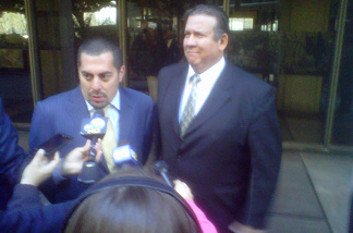 Defense Attorney George Mgdesyan and his client, former Bell city councilman Luis Artiga, field reporters' questions outside criminal court in downtown Los Angeles on Monday