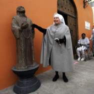 Sister Antonia Brenner touches the statue of San Pablo Encandenado (St. Paul chained) outside the chapel at the La Mesa State Penitentiary in a photograph taken in 2005.