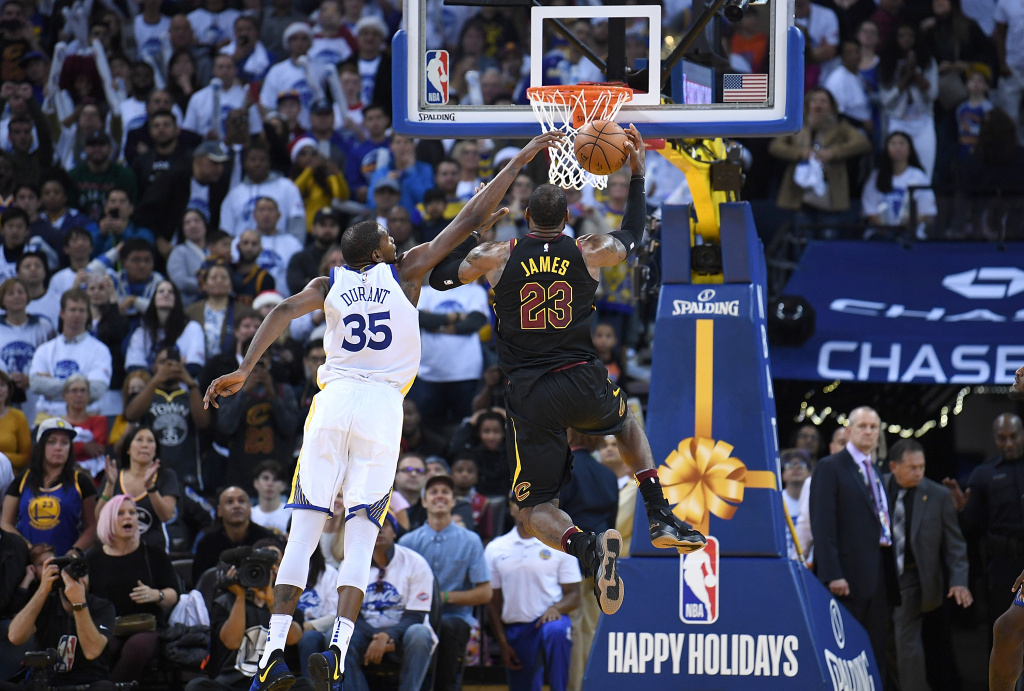 Kevin Durant #35 of the Golden State Warriors blocks the shot of LeBron James #23 of the Cleveland Cavaliers