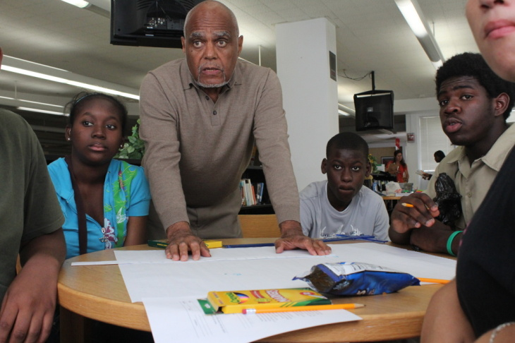 Bob Moses works with Jennifer Augustine, Guitoscard Denize, Darius Collins and other students who are part of this Algebra Project classroom. It's one of several student cohorts across the country where students who've struggled with math get to college-l