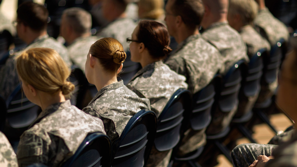 A lawsuit challenging the constitutionality of an all-male military draft could be revived, after the Pentagon changed its policy on women in combat. Here, soldiers attend a ceremony in Arlington, Va., earlier this year.