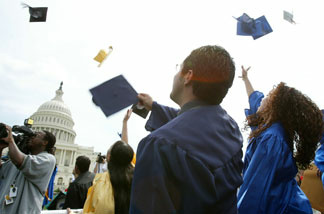 File photo: Students throw their caps during a mock graduation ceremony at the West Front of the U.S. Capitol April 20, 2004 in Washington, D.C.. Several hundred students and advocates took part in the ceremony and urged Congress and the Bush administration to pass the Dream Act, which would put U.S.-raised immigrant students on the path to college and U.S. citizenship.