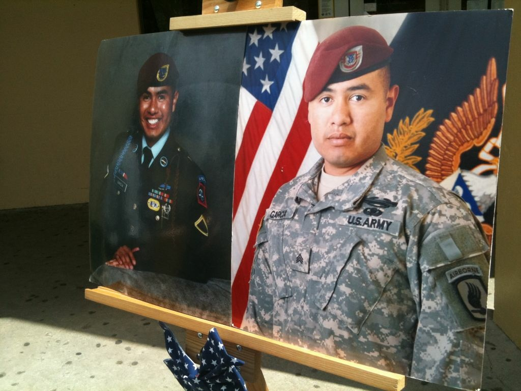 Sgt. Israel Garcia died in combat in Afghanistan in 2008. Friends and family unveiled a memorial bench in front of the library at Poly High School in Long Beach. Garcia graduated from the school in 2002.