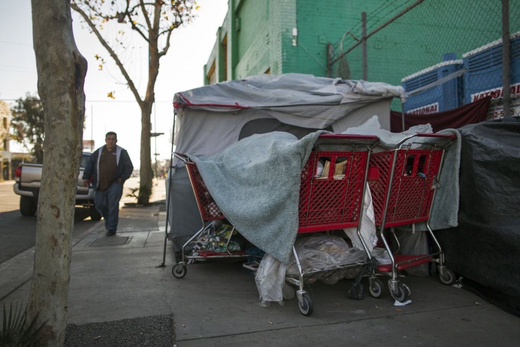 File: A tent stands on E Sixth Street at Gladys Avenue in Skid Row on Thursday morning, Dec. 17, 2015.