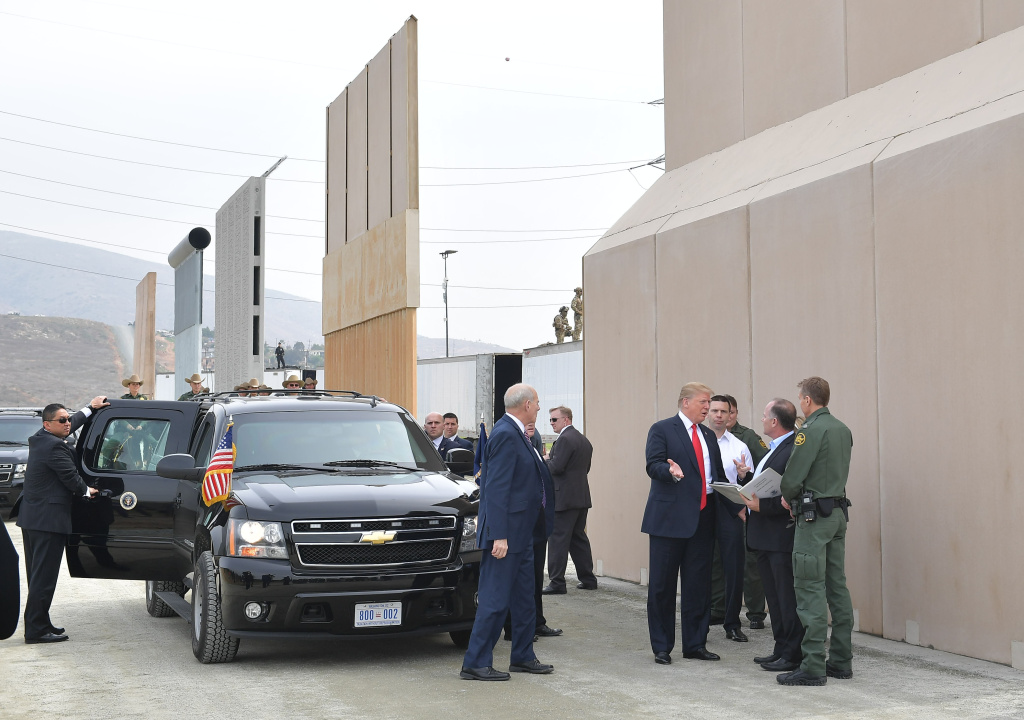 President Donald Trump is shown border wall prototypes in San Diego on March 13, 2018.
