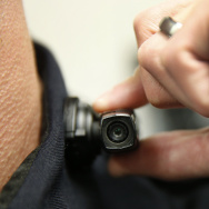 A West Valley City police officer shows off a newly-deployed body camera attached to his shirt collar on March 2, 2015 in West Valley City, Utah.