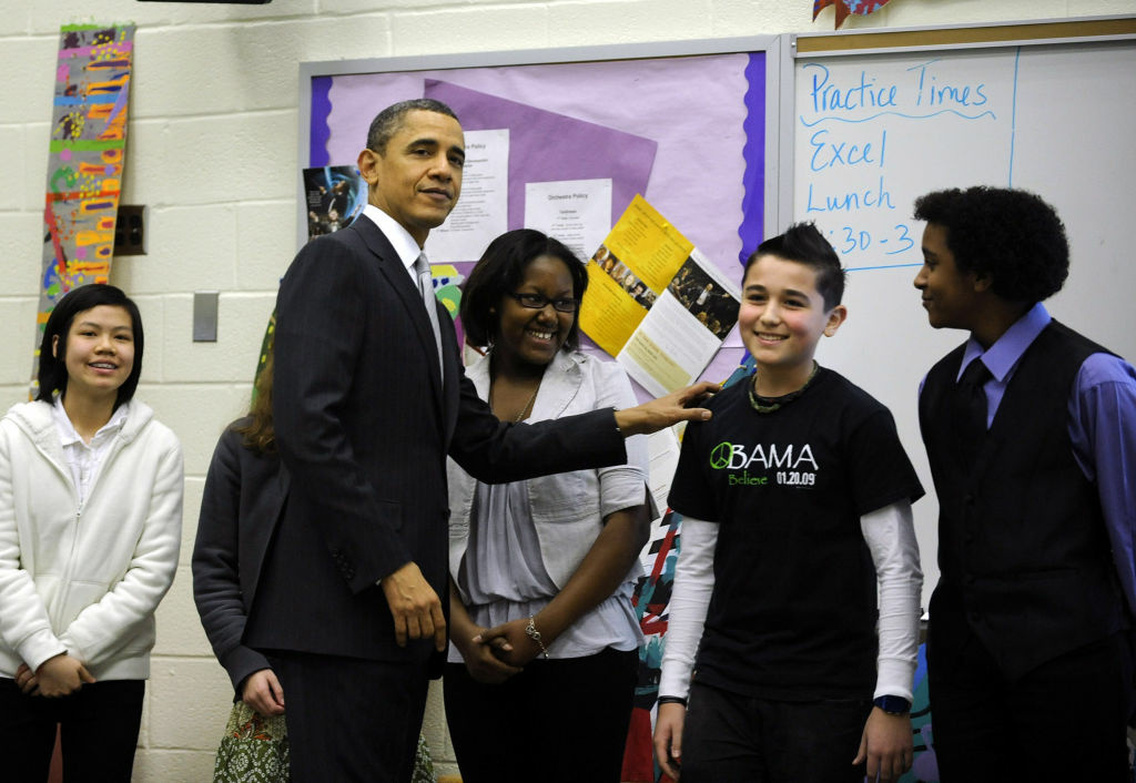 U.S. President Barack Obama visits with students in a classroom while at Kenmore Middle School to deliver a speech on reforming education March 14, 2011 in Arlington, Virginia. President Obama called on the Congress