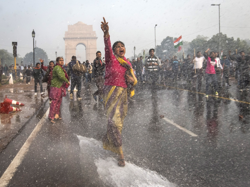 A protester chants slogans as she braces herself against the spray fired from police water canons during a protest in December sparked by the gang rape of a 23-year-old paramedical student.