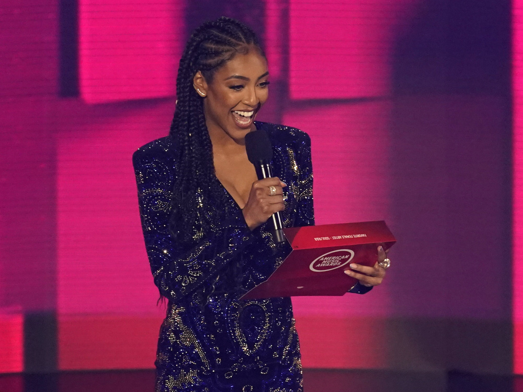 Tayshia Adams appears at the American Music Awards in Los Angeles on Nov. 22, 2020. She will co-host <em>The Bachelorette</em> with Kaitlyn Bristowe, Warner Horizon and ABC Entertainment announced.