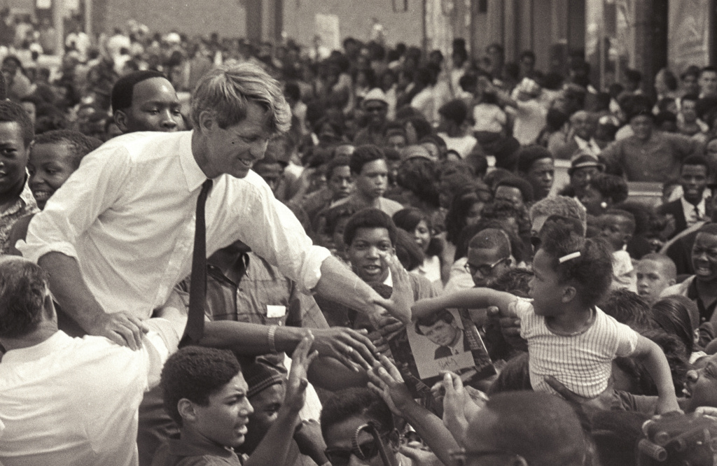 Robert F. Kennedy stands in an open-top convertible and shakes hands with members of a crowd as he campaigns for the democratic Presidential nomination in Detroit, May 15, 1968. (Photo by Andrew Sacks/Getty Images)