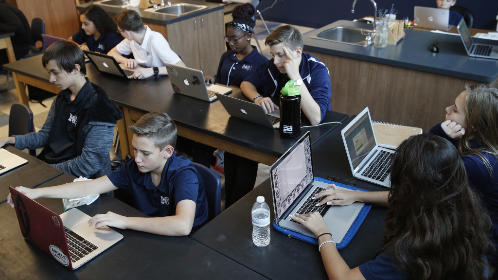 Students work on computers in Henderson, Nev. Several states including Utah and Ohio use automated grading on student essays written as part of standardized tests.