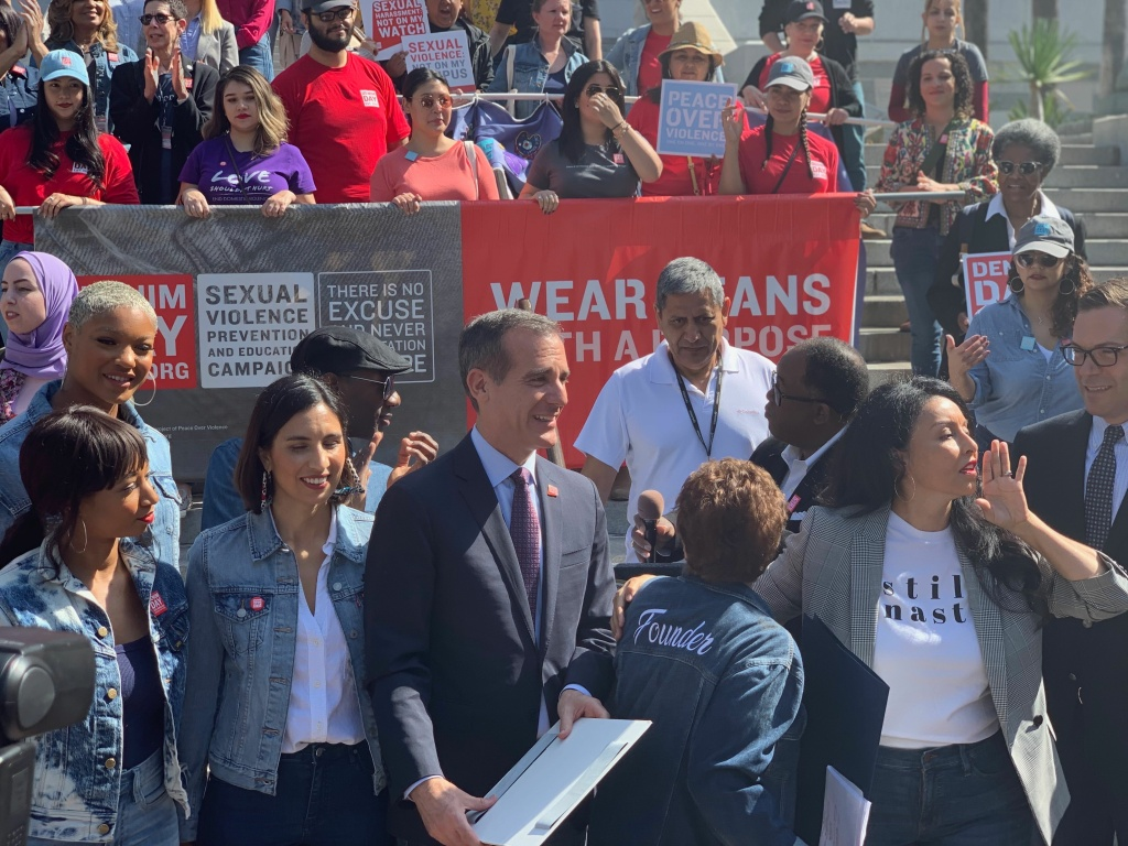 L.A. Mayor Eric Garcetti (center) stands with Denim Day activists and L.A. City Councilmember Nury Martinez (right).